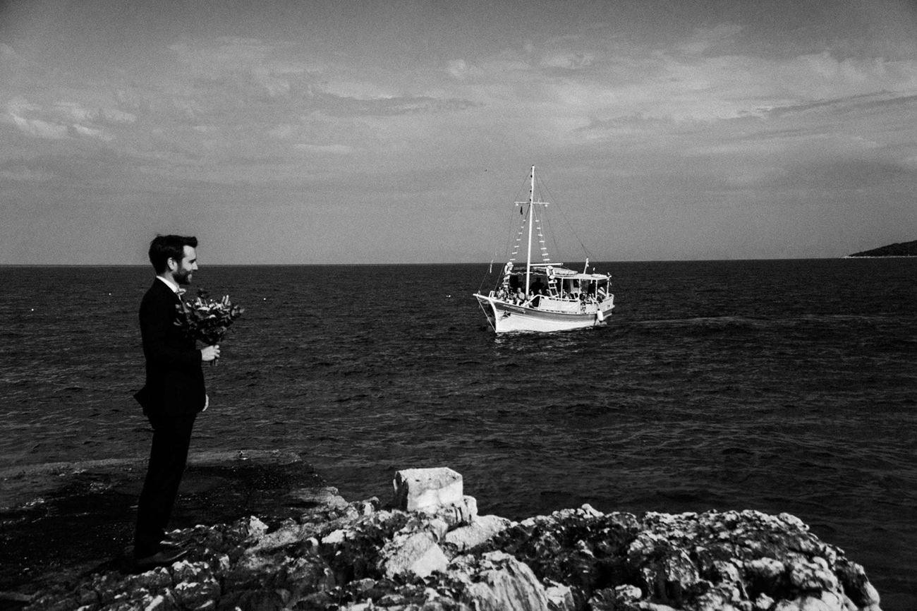 Paxos Wedding Videographer filming a Lebanese destination Wedding in Paxos groom waiting