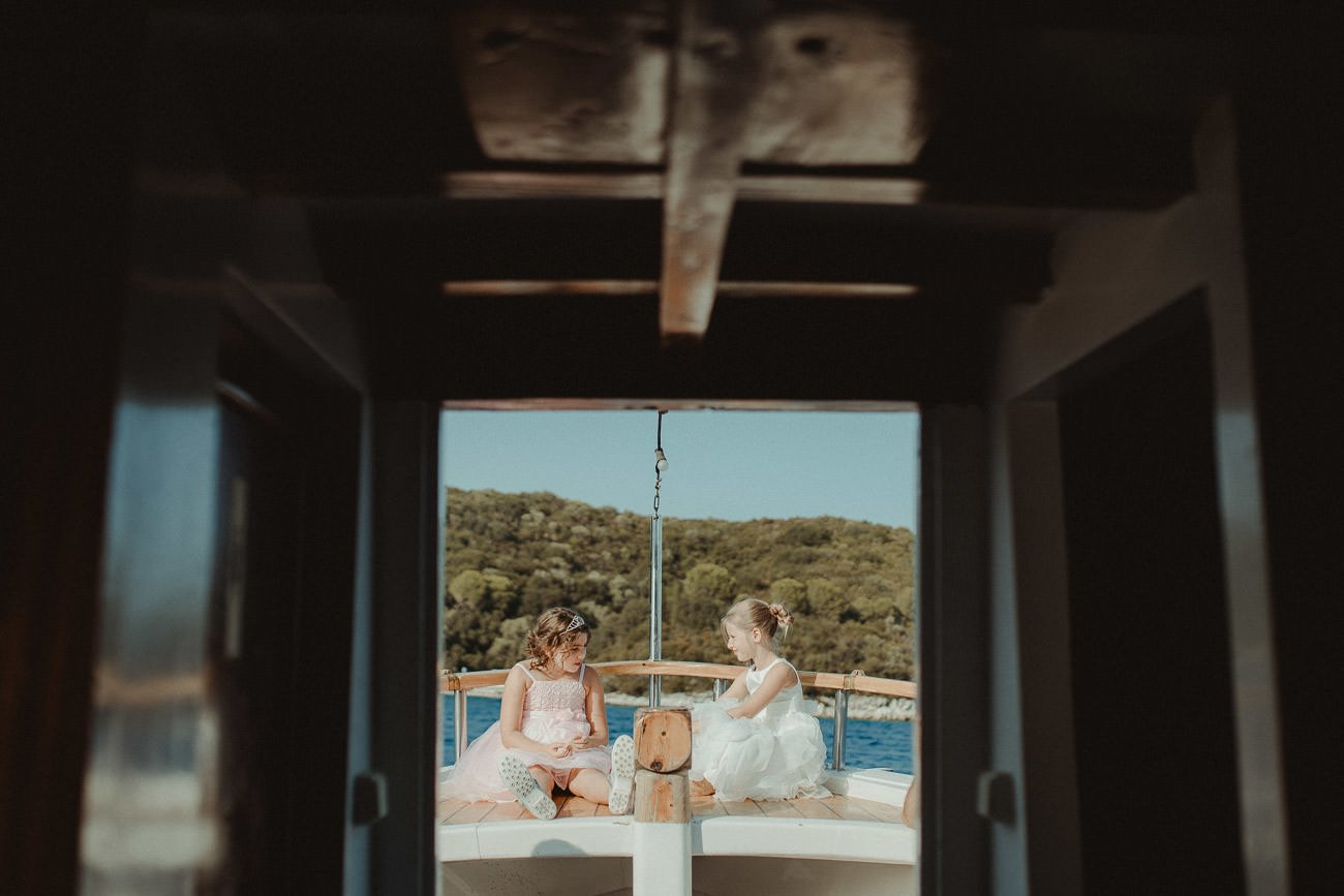 Young bridesmaids in Lefkada sailing after wedding