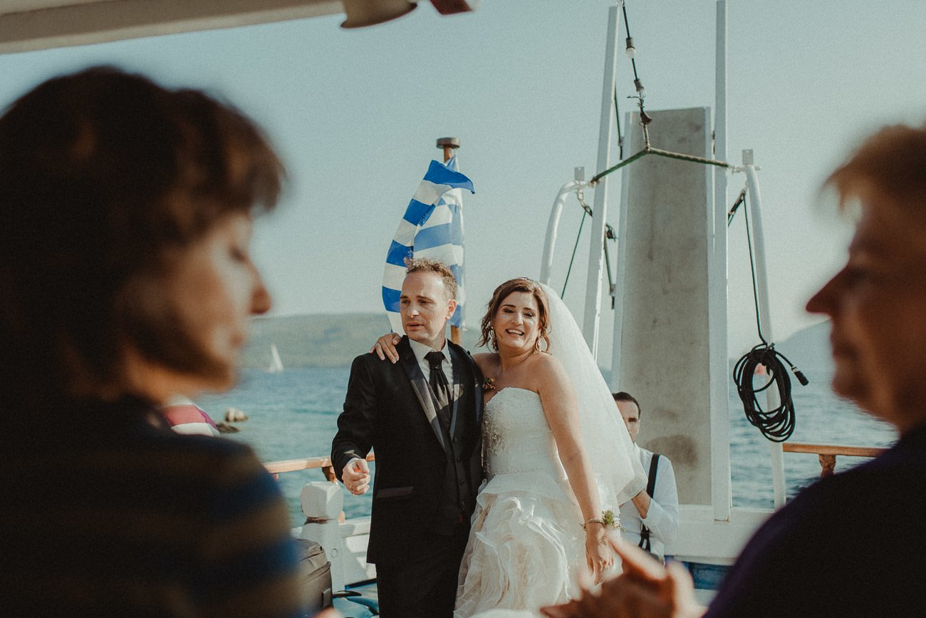 Lefkada wedding videographer filming couple singing and dancing