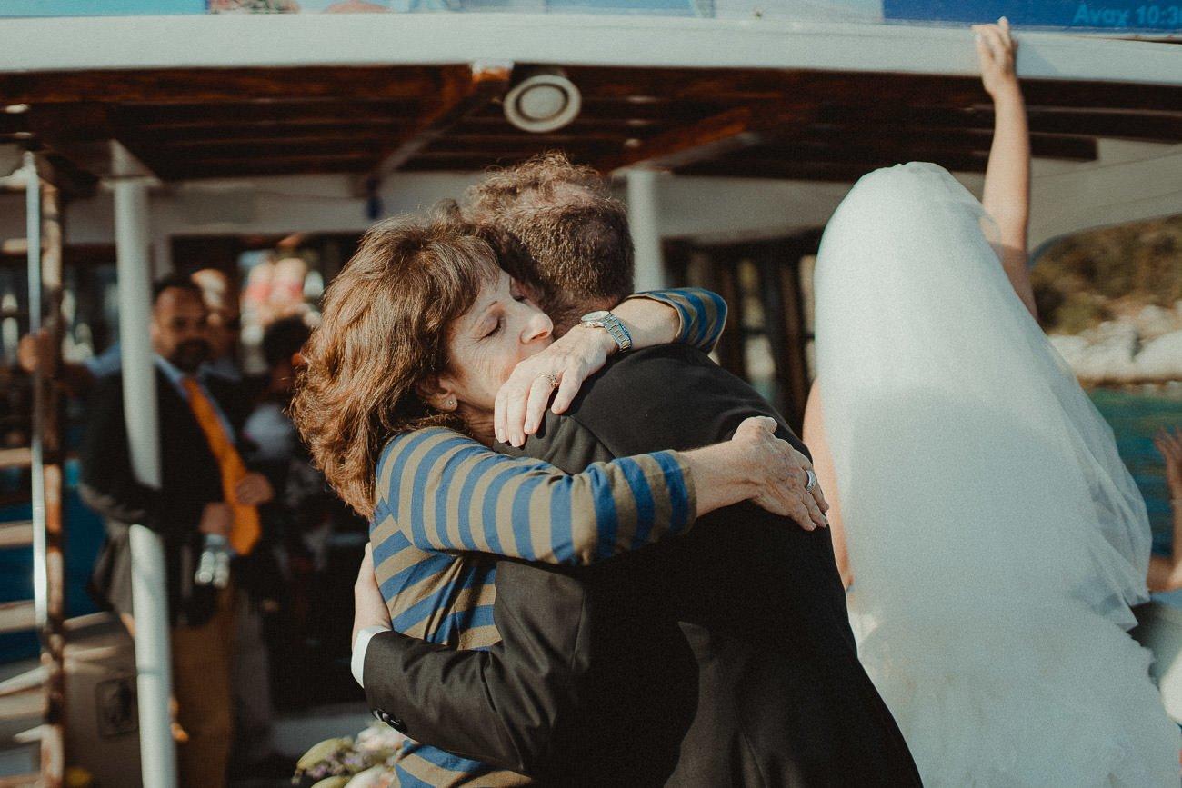 Lefkada wedding videographer filming a big hug between groom and his mother