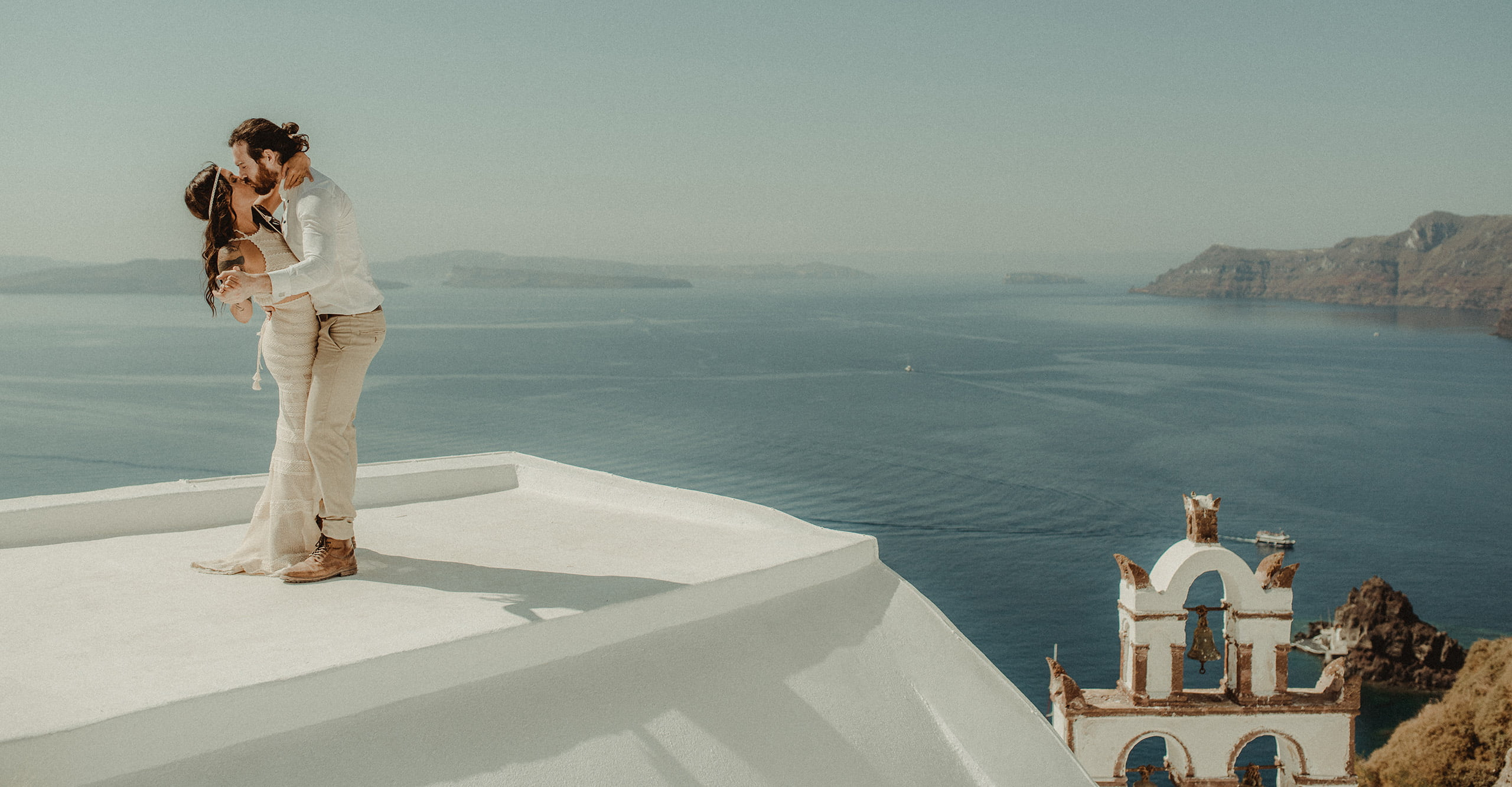 Santorini Elopement filmed by Wedding filmmaker Kostas Petsas