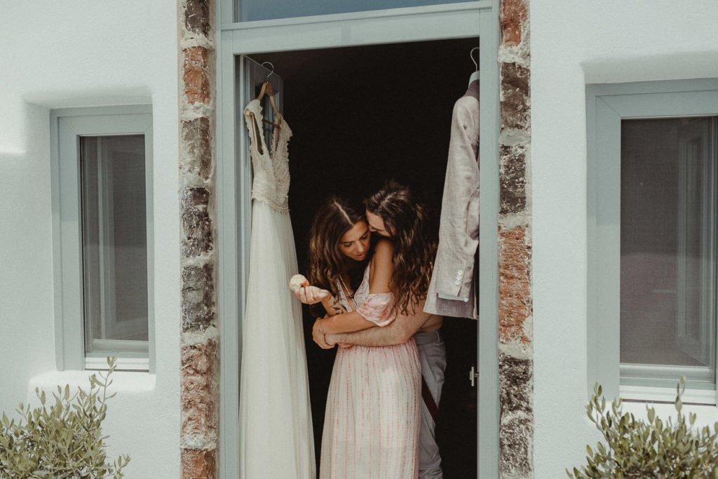 Santorini Wedding Videographer filming an Elopement getting ready in Antrum Villa
