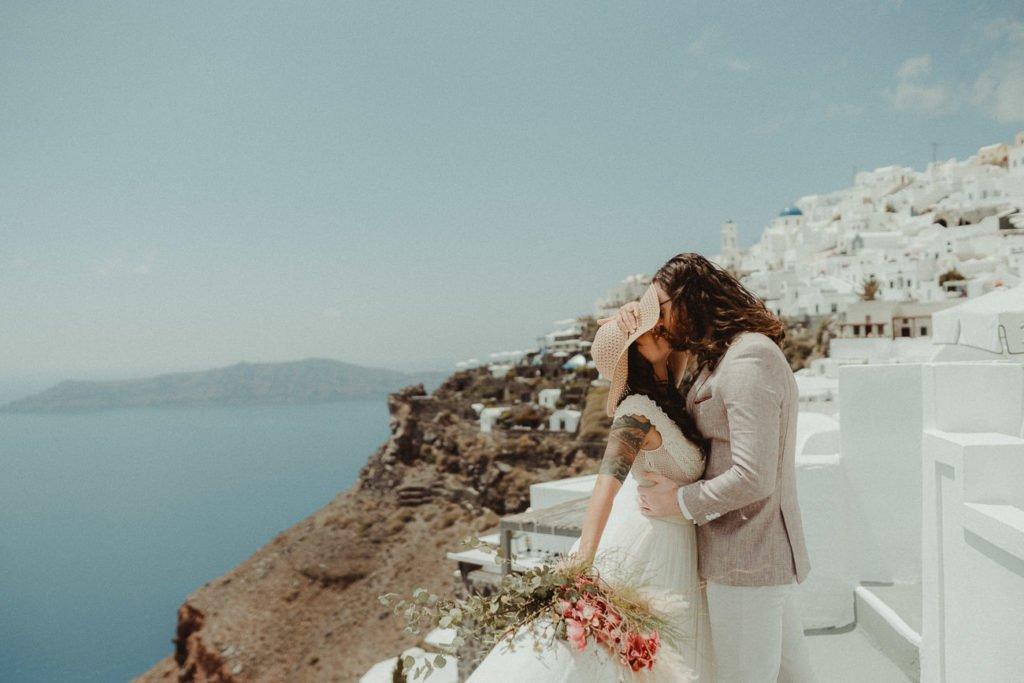 Santorini Wedding Videographer filming an Elopement wedding couple in Imerovigli