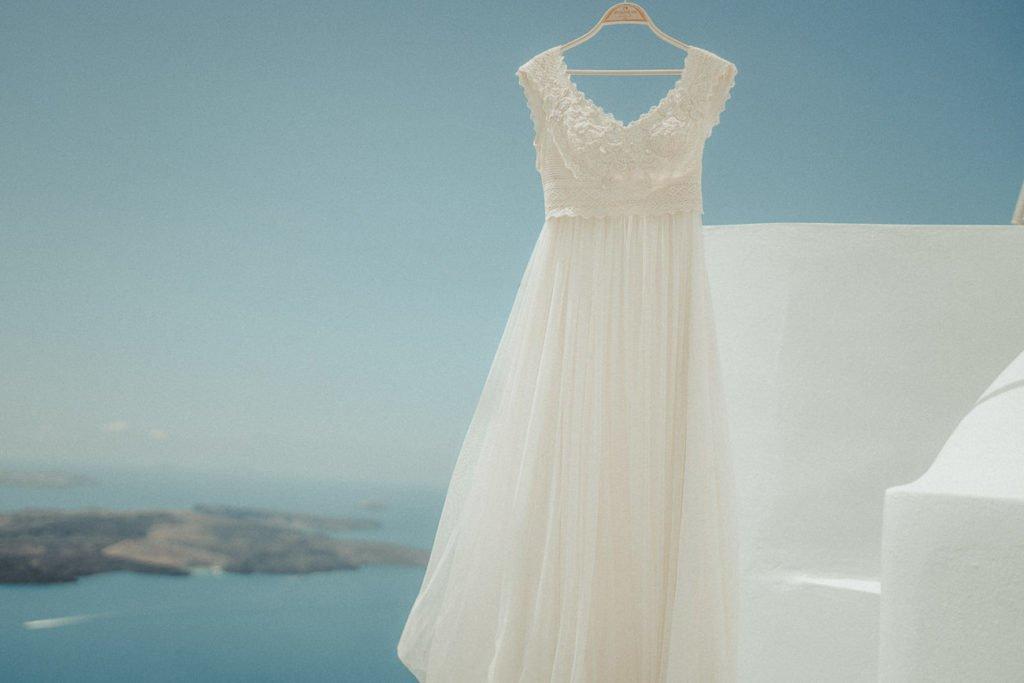 Santorini wedding videographer filming an Atelier Zolotas wedding dress for an Elopement