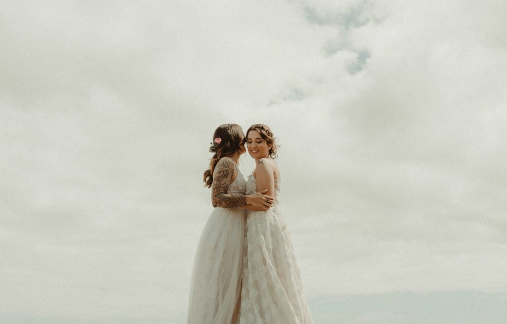 Two brides Same-sex LGBT wedding in the Caldera Santorini