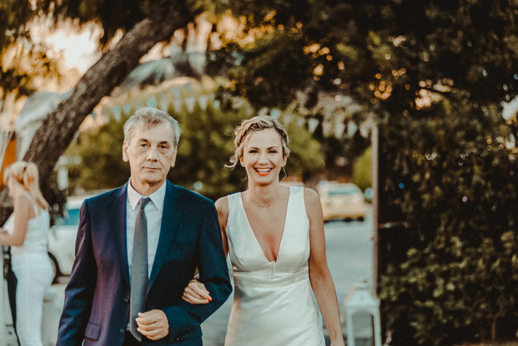 Athens Riviera Wedding Videographer filming ceremony in Lake Vouliagmeni