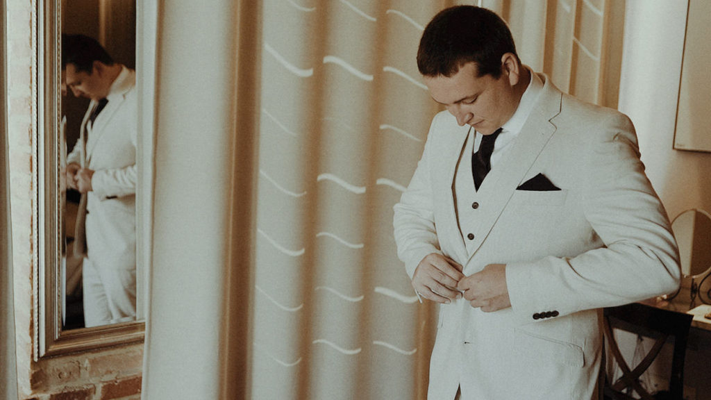Groom preps in Villa Rey Umbria