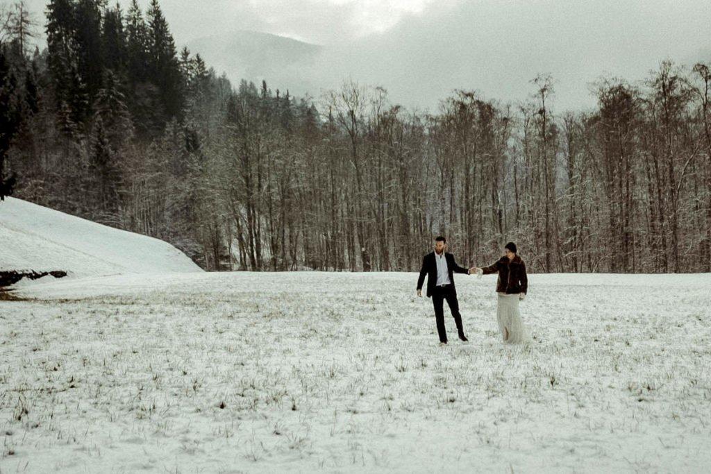 Austrian Alps wedding videographer filming winter elopement