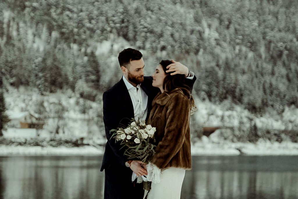 Austrian Alps wedding videographer filming winter elopement in Lake Achensee Tirol
