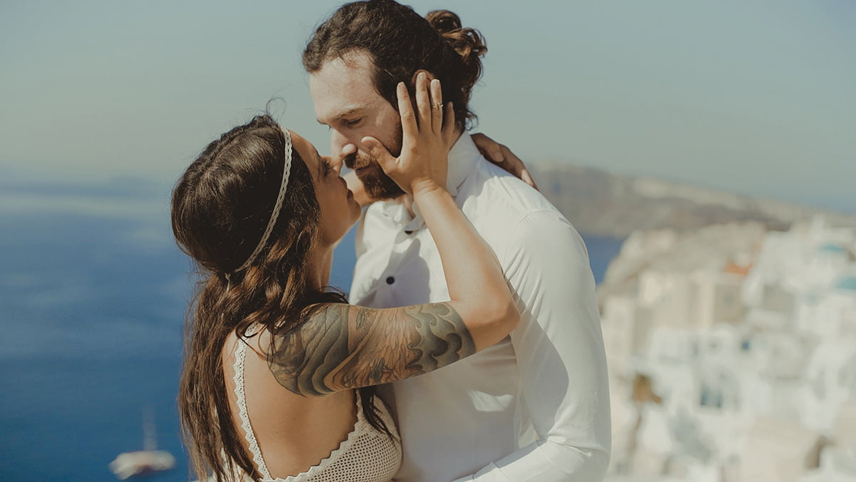 Couple in Santorini picture after applying the Poetry wedding film LUTs