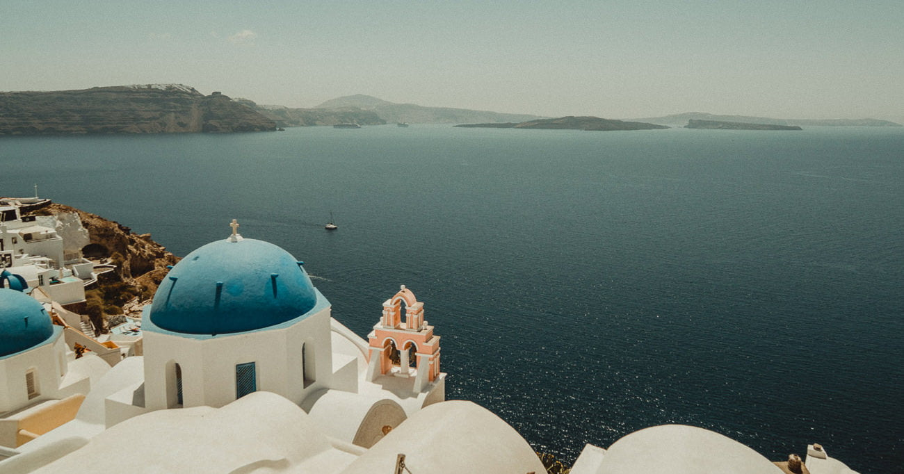 Best Wedding Venues in Santorini present a stunning view of the Caldera