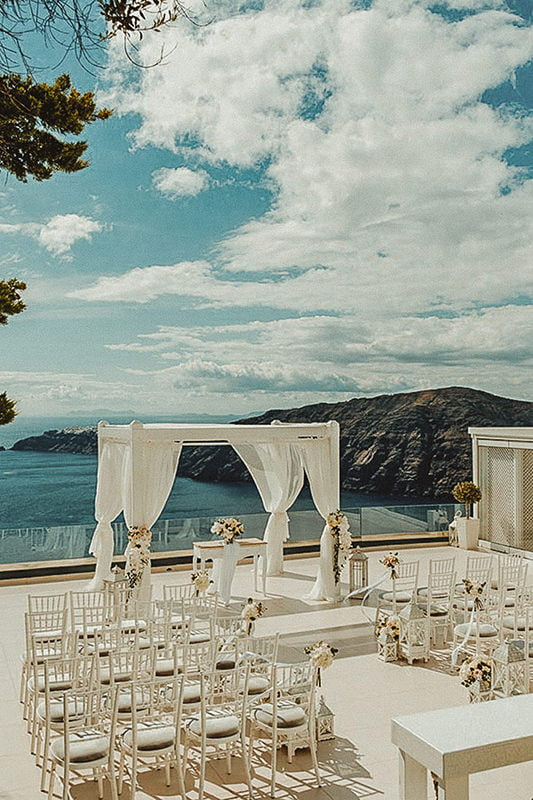Beautiful wedding ceremony in the terrace of Le Ciel Santorini one of the top places to get married in Santorini Imerovigli