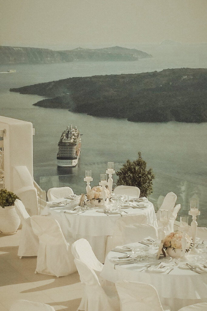 Stunning view from the terrace of Dana Villas one of the best wedding venues in Santorini Firostefani