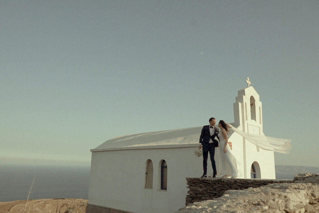 Kythnos Wedding Videographer shooting a beautiful image of the couple