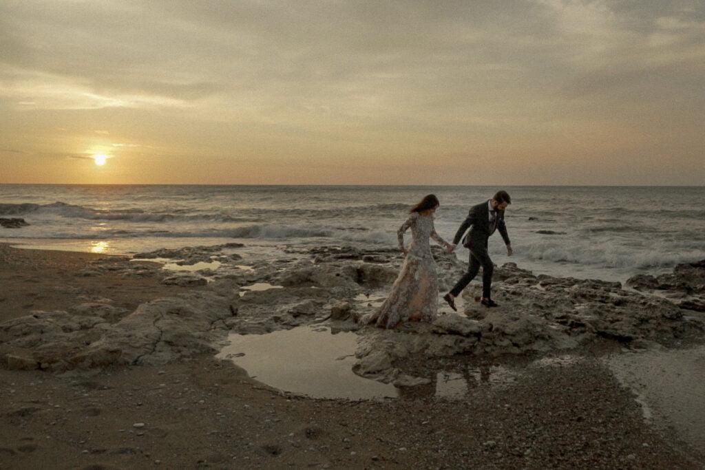 fine art wedding videographer filming an alternative couple