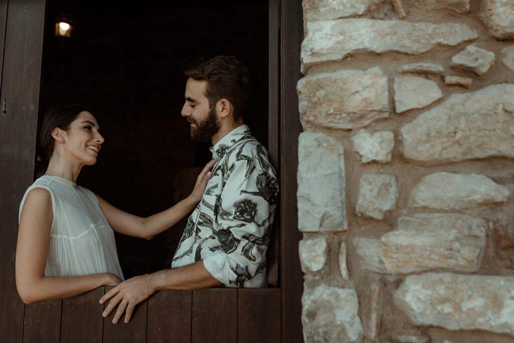 Creative wedding videographer filming an alternative couple