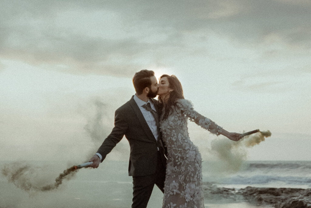 An alternative first kiss on the beach filmed by a fine art wedding videographer for a non-traditional visual poetry film
