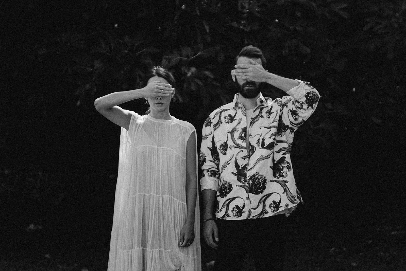 Alternative wedding videographer filming an artistic couple for a fine art wedding film