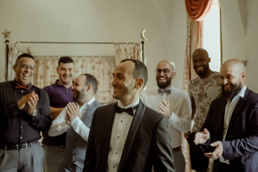groom getting ready with his groomsmen for a french castle wedding