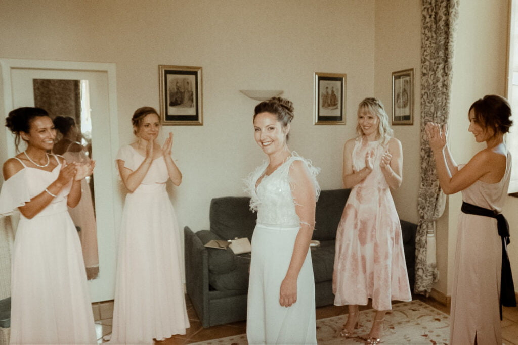 bride getting ready with her bridesmaids for a french castle wedding