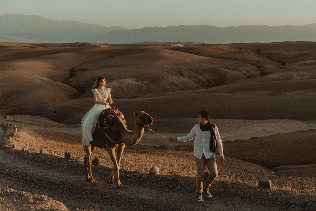 Morocco Elopement Wedding couple with a camel in the desert