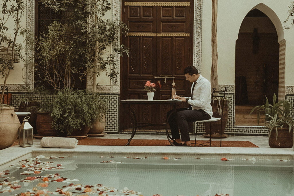 Groom writing his vows in a Morocco Riad